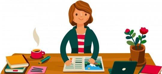 Una monitrice seduta ad una scrivania leggo un opuscolo.