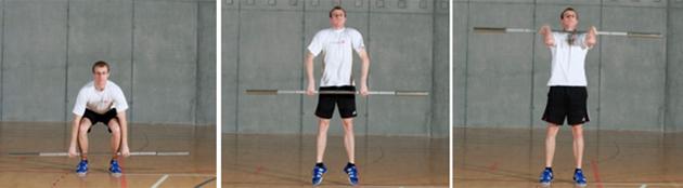 Un athlète soulève une barre du sol jusqu'à hauteur d'épaules.